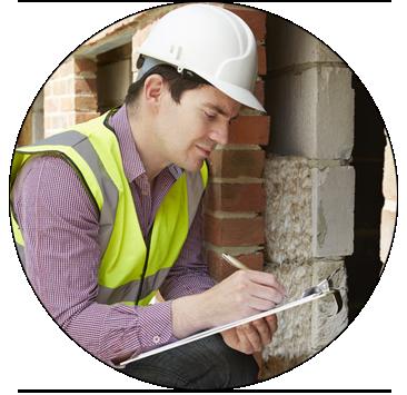 man inspecting building