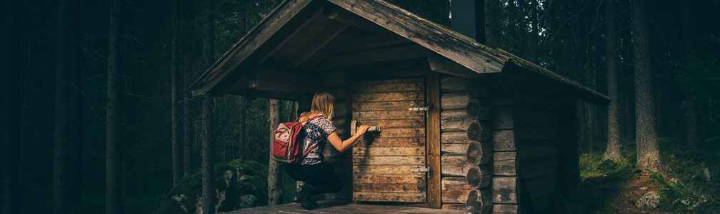 woman entering small house