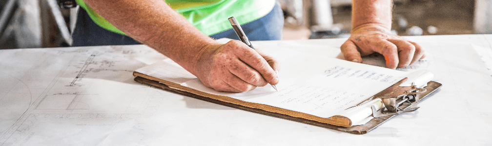 Worker writing report