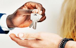 Broker handing keys to buyer