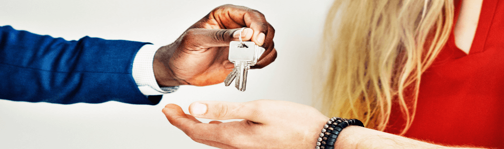 Broker handing keys to buyer