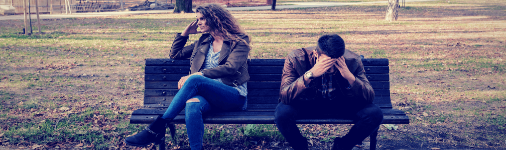 upset couple sitting on bench
